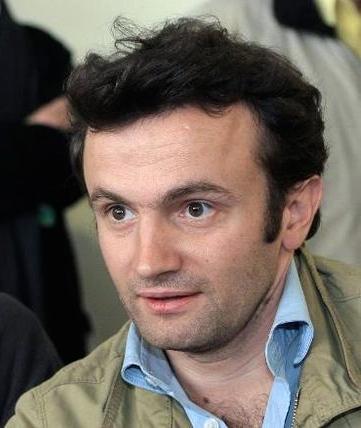 thomas_668723-le-journaliste-francais-thomas-dandois-d-et-pierre-creisson-g-le-19-janvier-2008-a-l-aeroport-d-orly-4.jpg